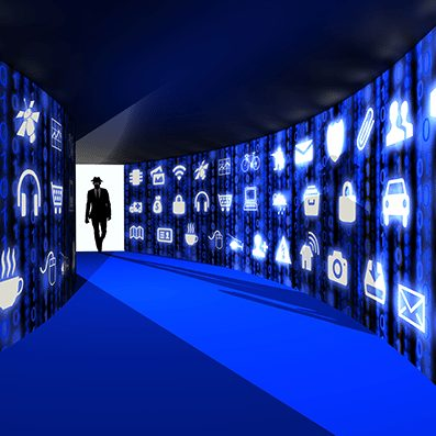 blue hallway with icons on walls and man in suit at the end